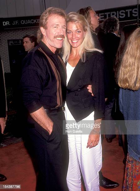 Actor Chuck Norris and date attend the 'Double Impact' Westwood Premiere on August 8 1991 at Mann Village Theatre in Westwood California