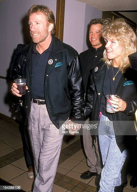 Actor Chuck Norris and date Monica Hall attend the Opening Night Performance of The Moscow Circus on March 14 1990 at the Great Western Forum in...
