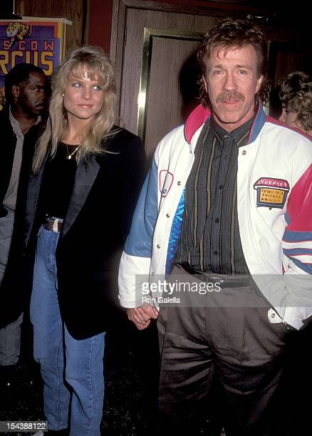 Actor Chuck Norris and date Monica Hall attend the Opening Night Performance of The Moscow Circus on March 6 1991 at the Great Western Forum in...