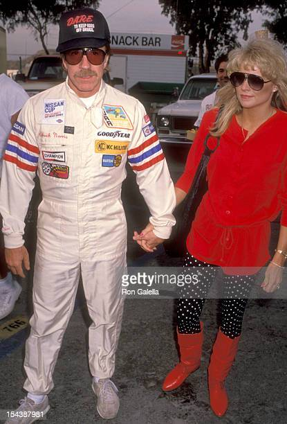 Actor Chuck Norris and date Monica Hall attend the Second Annual Reid Rondell Foundation Enduro 150 on October 6 1990 at Saugus Speedway in Saugus...
