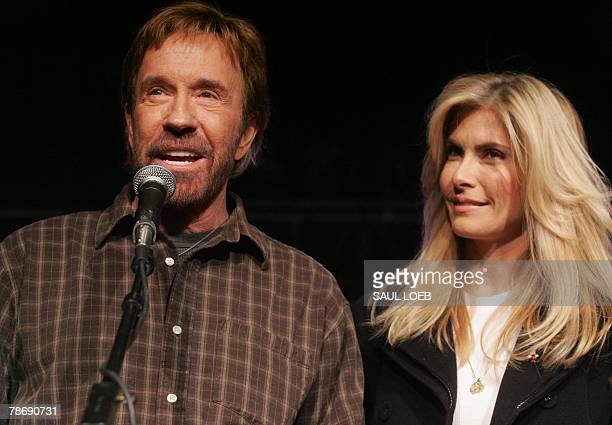 US Actor Chuck Norris and his wife Gena O'Kelley speak during a 'Huck and Chuck' rally for Republican Presidential hopeful and former Arkansas...