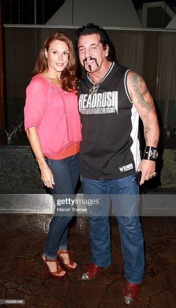 Actor <a gi-track='captionPersonalityLinkClicked' href=/galleries/search?phrase=Chuck+Zito&family=editorial&specificpeople=785523 ng-click='$event.stopPropagation()'>Chuck Zito</a> (R) and Juliette Frette visit his HEADRUSH booth at the 2012 MAGIC Convention at Mandalay Bay Hotel on August 21, 2012 in Las Vegas, Nevada.