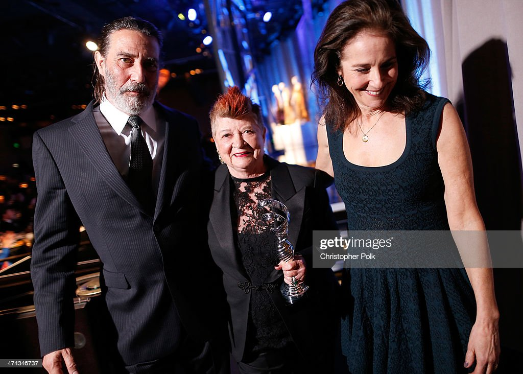 Actor Ciarán Hinds, honoree April Ferry, and Actress Debra Winger attend the 16th Costume Designers Guild Awards with presenting sponsor Lacoste at The Beverly Hilton Hotel on February 22, 2014 in Beverly Hills, California.