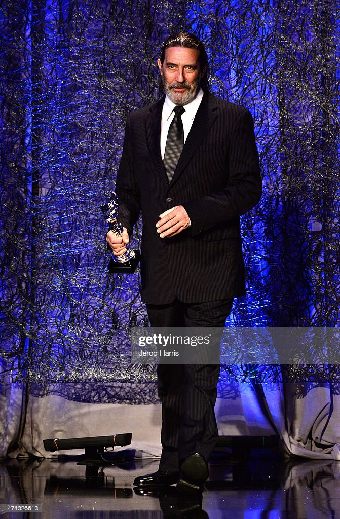 Actor Ciarán Hinds speaks onstage during the 16th Costume Designers Guild Awards with presenting sponsor Lacoste at The Beverly Hilton Hotel on February 22, 2014 in Beverly Hills, California.