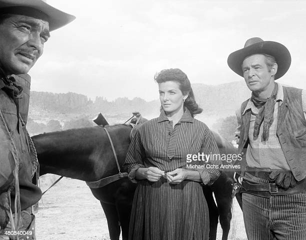 Actor Clark Gable actress Jane Russell and Robert Ryan on set for the 20th Century Fox movie 'The Tall Men' circa 1955