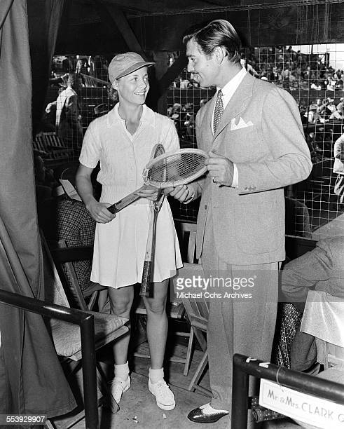 Actor Clark Gable and tennis star Alice Marble talk during an event in Los Angeles California