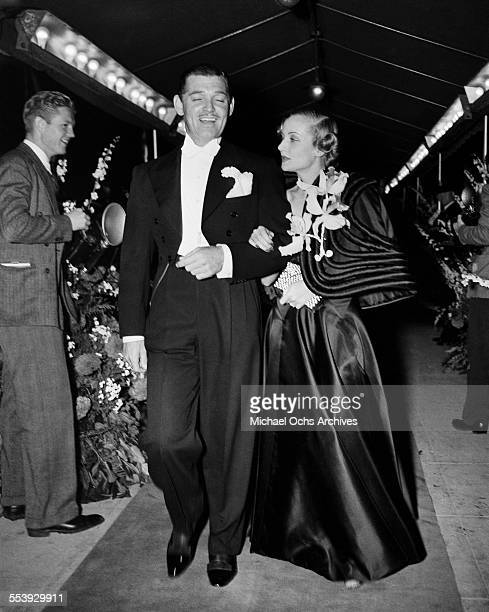 Actor Clark Gable and wife actress Carole Lombard attend an event in Los Angeles California