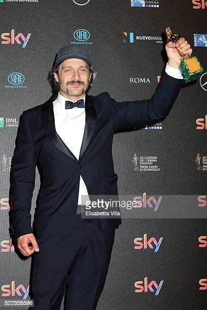 Actor Claudio Santamaria poses with his David di Donatello award for Best Actor at the 60 David di Donatello ceremony on April 18 2016 in Rome Italy