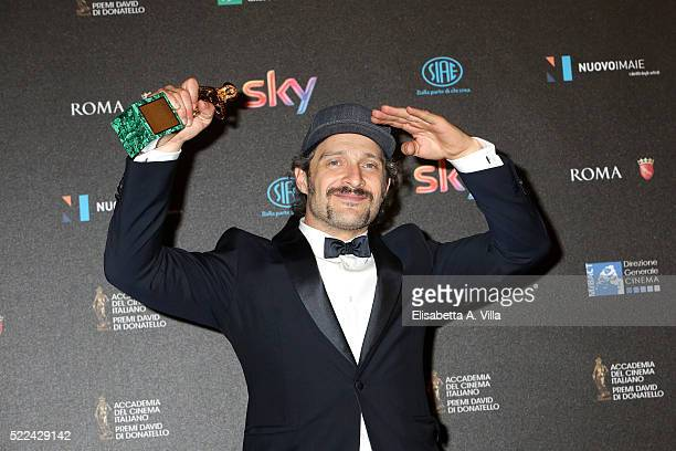 Actor Claudio Santamaria poses with his David di Donatello award for Best Actor at the 60 David di Donatello ceremony on April 18 2016 in Rome Italy