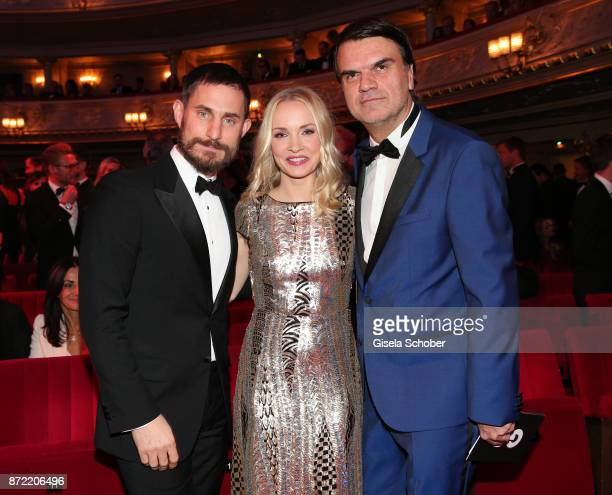 Actor Clemens Schick actress Janin Ullmann and GQ publisher Andre Pollmann arrives for the GQ Men of the year Award 2017 at Komische Oper on November...