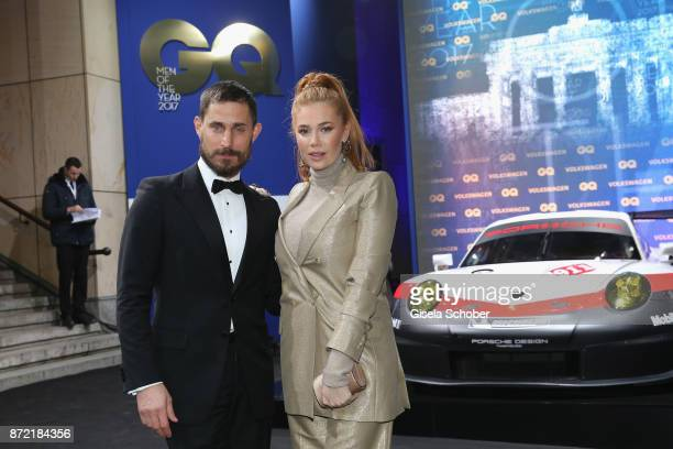 Actor Clemens Schick and actress Palina Rojinski arrives for the GQ Men of the year Award 2017 at Komische Oper on November 9 2017 in Berlin Germany