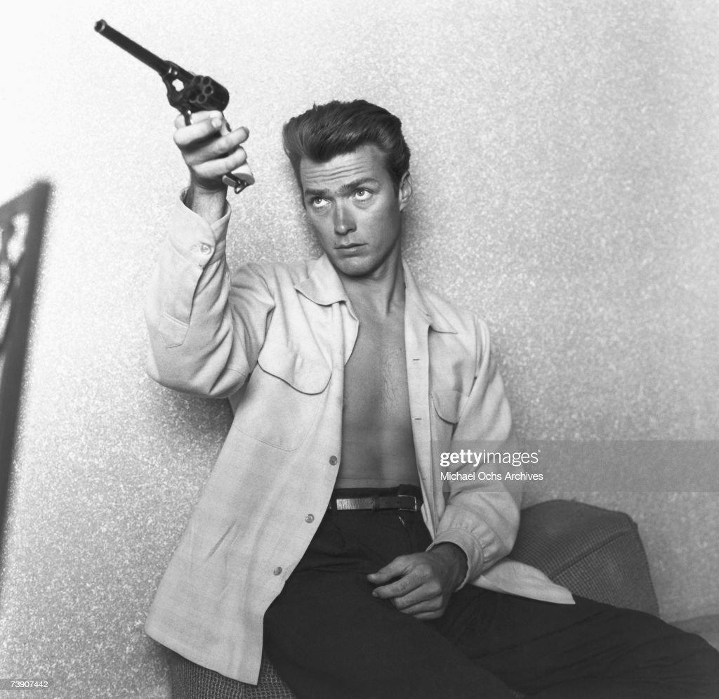 [Image: actor-clint-eastwood-checks-his-gun-at-h...id73907442]