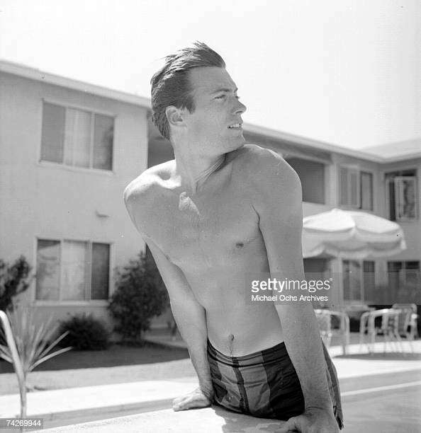 Actor Clint Eastwood leans against the diving board at home on June 1 1956 in Los Angeles California