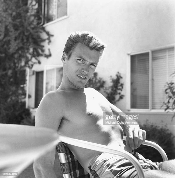 Actor Clint Eastwood relaxes in a chair outside his home on June 1 1956 in Los Angeles California