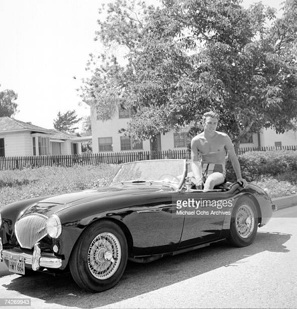 Actor Clint Eastwood sits the back of a convertible Austin Healey sportscar on June 1 1956 in Los Angeles California