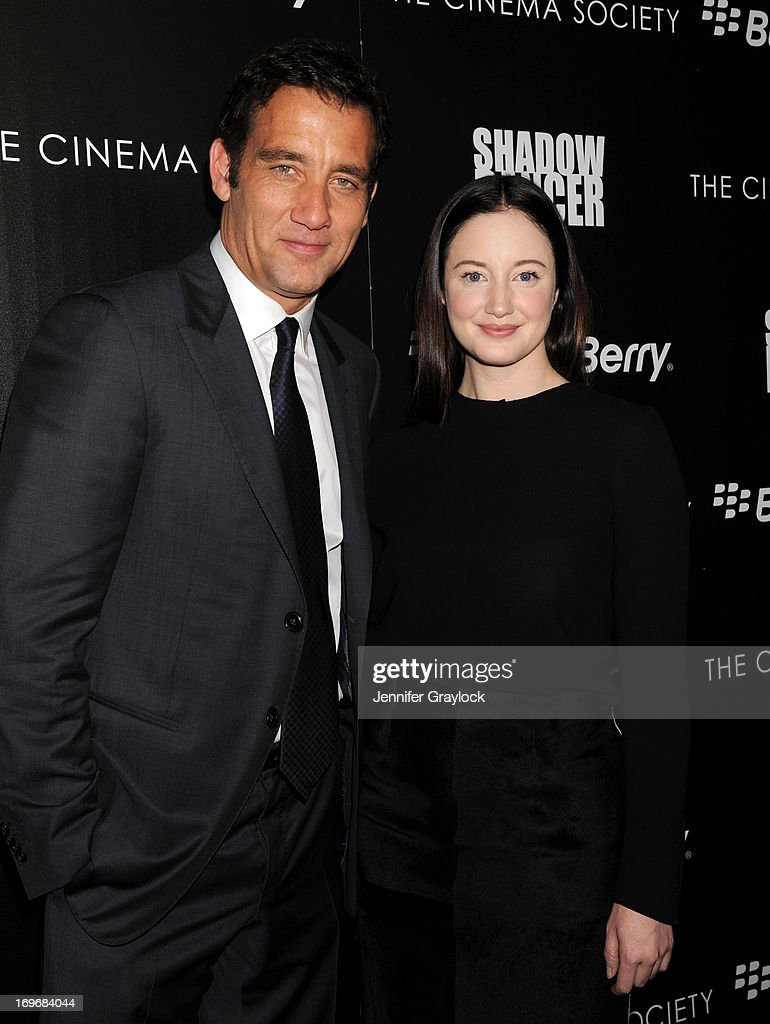 Actor <a gi-track='captionPersonalityLinkClicked' href=/galleries/search?phrase=Clive+Owen&family=editorial&specificpeople=201515 ng-click='$event.stopPropagation()'>Clive Owen</a> and Actress <a gi-track='captionPersonalityLinkClicked' href=/galleries/search?phrase=Andrea+Riseborough&family=editorial&specificpeople=4395380 ng-click='$event.stopPropagation()'>Andrea Riseborough</a> attend The Cinema Society & BlackBerry Host A Screening Of Magnolia Pictures' 'Shadow Dancer' at Sunshine Landmark on May 30, 2013 in New York City.