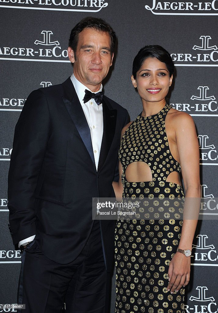 Actor <a gi-track='captionPersonalityLinkClicked' href=/galleries/search?phrase=Clive+Owen&family=editorial&specificpeople=201515 ng-click='$event.stopPropagation()'>Clive Owen</a> and actress <a gi-track='captionPersonalityLinkClicked' href=/galleries/search?phrase=Freida+Pinto&family=editorial&specificpeople=5518973 ng-click='$event.stopPropagation()'>Freida Pinto</a> attend a gala dinner hosted by Jaeger-LeCoultre celebrating The Rendez-Vous Collection at Giustinian Palace in Venice during the 69th Venice Film Festival on September 4, 2012 in Venice, Italy.
