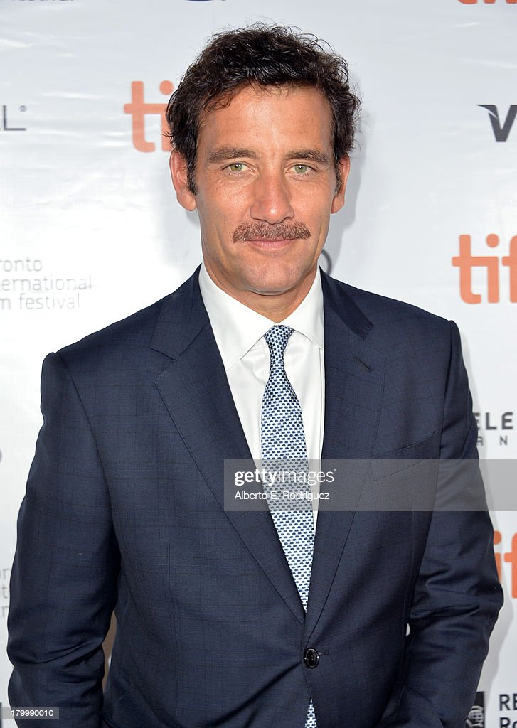 Actor Clive Owen attends the 'Words And Pictures' premiere during the 2013 Toronto International Film Festival at Roy Thomson Hall on September 7...