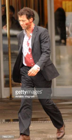Actor Clive Owen walks away after filming a scene on the set of 'The International' January 13 2008 in New York City