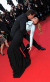 Actor Clovis Cornillac and Lilou Fogli attend the 'The Artist' Premiere at the Palais des Festivals during the 64th Cannes Film Festival on May 15...