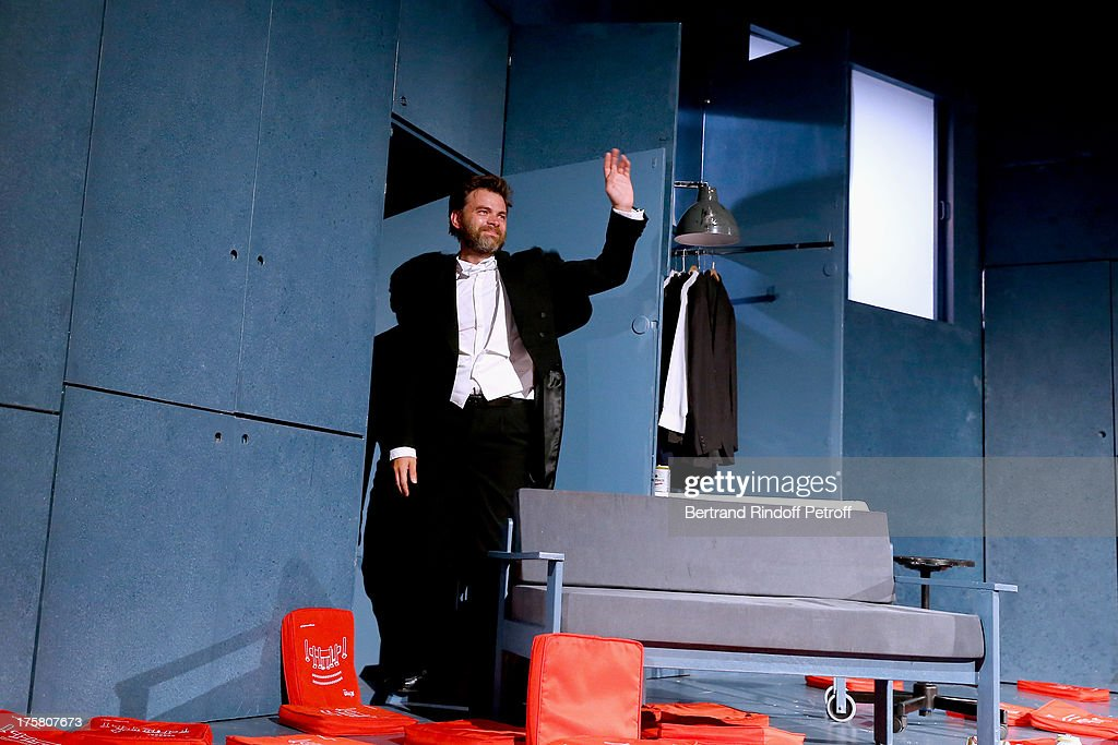 Actor Clovis Cornillac during the traditional throw of cushions at the final of 'La Contrebasse' play at 29th Ramatuelle Festival : Day 9 on August 8, 2013 in Ramatuelle, France.