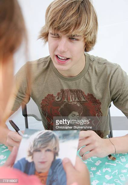 Actor Cody Linley signs autographs for fans at the Operation Rescue Kit game Mobile Rescue Unit booth at the State Fair of Texas at Fair Park on...