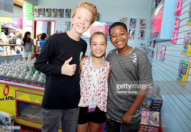 Actor Cody Veith Brandon Severs and Jillian Shea Spaeder play with guests at the Ring Toss both during the 17th Annual Mattel Party on the Pier on...