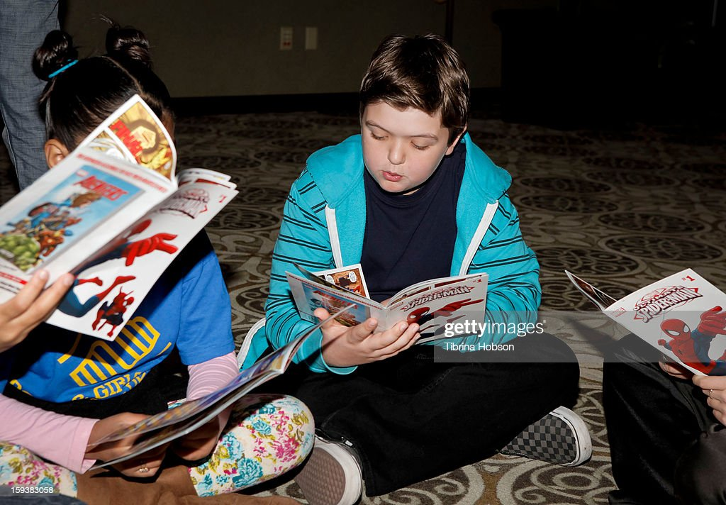 Actor Cole Jensen (C) reads to a group of children at the 'Reading With: Marvel Comics Close-Up' kick-off event at the Burbank Public Library on January 12, 2013 in Burbank, California.