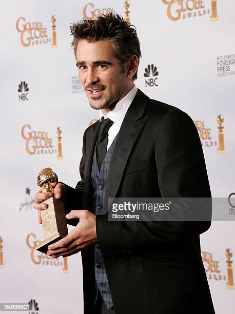 Actor Colin Farrell poses his award for Best Performance by an Actor in a Motion Picture at the 66th Annual Golden Globe Awards in Beverly Hills...