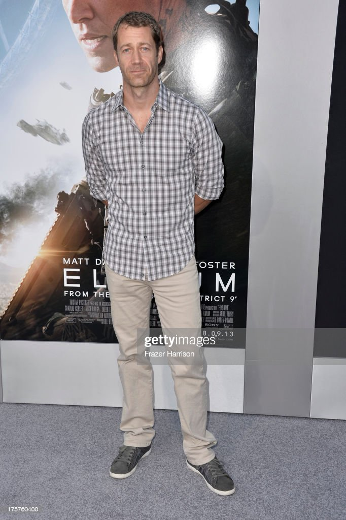 Actor Colin Ferguson arrives at the premiere of TriStar Pictures' 'Elysium' at Regency Village Theatre on August 7, 2013 in Westwood, California.