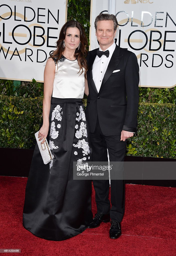 Actor Colin Firth and producer Livia Giuggioli attend the 72nd Annual Golden Globe Awards at The Beverly Hilton Hotel on January 11 2015 in Beverly...