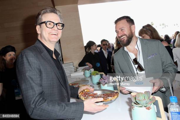 Actor Colin Firth hands out pizza at ATT's Jon Vinny's popup pizza bar at the 2017 Film Independent Spirit Awards sponsored by ATT at Santa Monica...