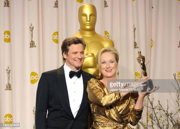 Actor Colin Firth poses with actress Meryl Streep winner of the Best Actress Award for 'The Iron Lady' in the press room at the 84th Annual Academy...