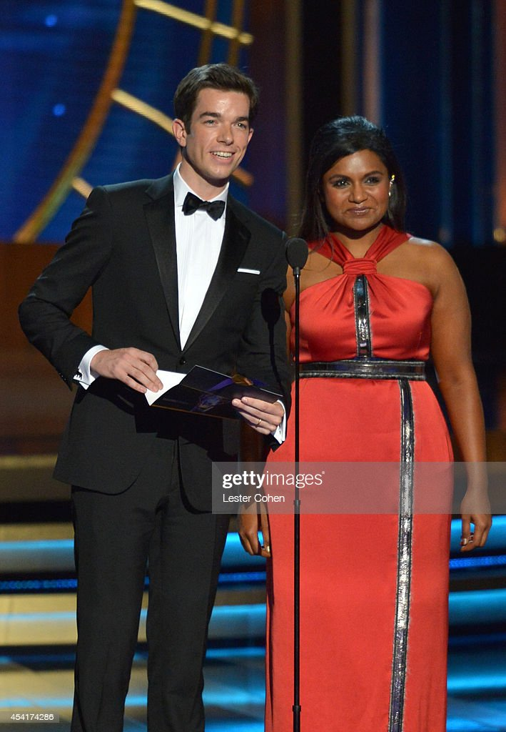 Actor Colin Hanks (L) and actress Mindy Kaling speak onstage at the 66th Annual Primetime Emmy Awards held at Nokia Theatre L.A. Live on August 25, 2014 in Los Angeles, California.