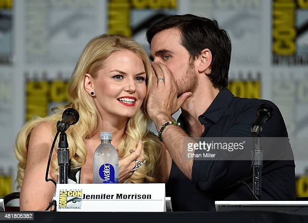 Actor Colin O'Donoghue whispers to actress Jennifer Morrison as they attend the 'Once Upon a Time' panel during ComicCon International 2015 at the...