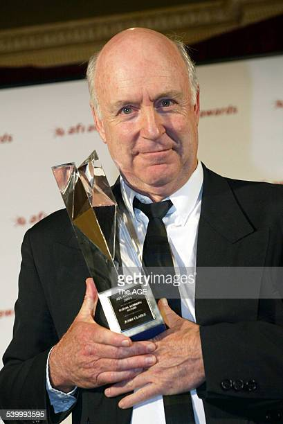 Actor / comedian John Clarke with his award at the AFI Awards at the Regent Theatre in Melbourne 29 October 2004 THE AGE Picture by ANGELA WYLIE