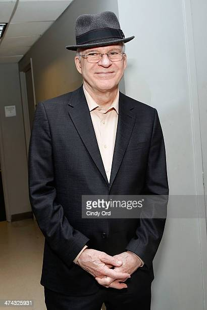 Actor/ comedian/ musician Steve Martin poses backstage at The Woody Guthrie Prize honoring Pete Seeger at Peter Norton Symphony Space on February 22...