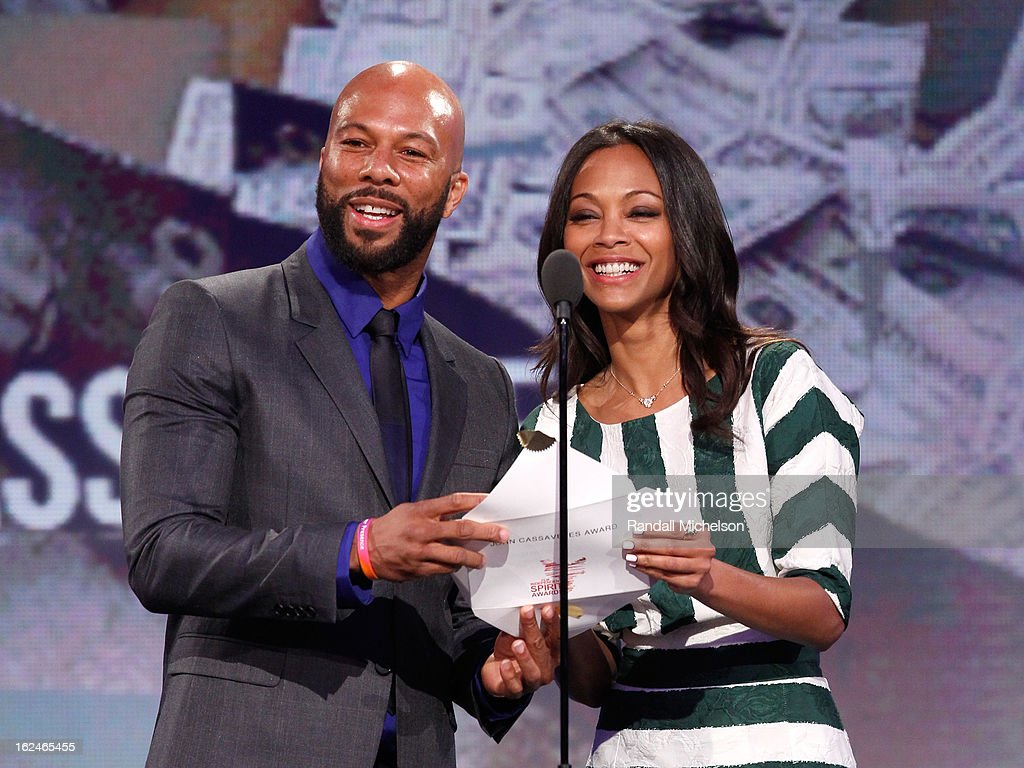 Actor Common (L) and actress <a gi-track='captionPersonalityLinkClicked' href=/galleries/search?phrase=Zoe+Saldana&family=editorial&specificpeople=542691 ng-click='$event.stopPropagation()'>Zoe Saldana</a> speak onstage during the 2013 Film Independent Spirit Awards at Santa Monica Beach on February 23, 2013 in Santa Monica, California.
