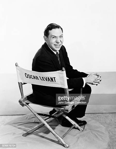 Actor composer and pianist Oscar Levant in a directors' chair at the time of his appearance in the 1955 movie The Cobweb