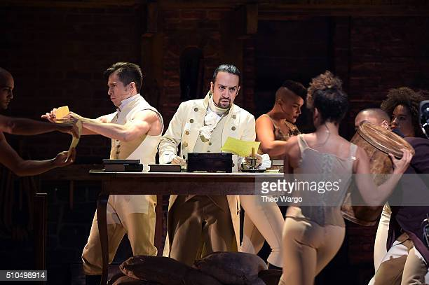 Actor composer LinManuel Miranda and actor Jon Rua perform on stage during 'Hamilton' GRAMMY performance for The 58th GRAMMY Awards at Richard...