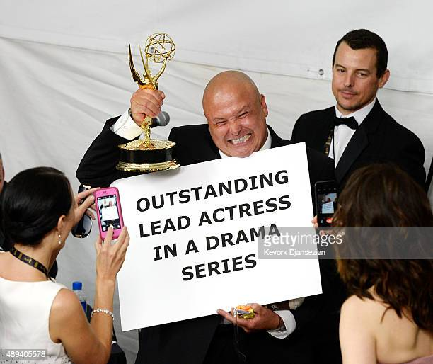 Actor Conleth Hill cast member of 'Game of Thrones' that won the Emmy Award for Outstanding Drama Series jokes around as he poses in the press room...