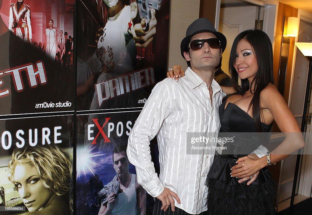 Actor <a gi-track='captionPersonalityLinkClicked' href=/galleries/search?phrase=Corey+Feldman&family=editorial&specificpeople=175941 ng-click='$event.stopPropagation()'>Corey Feldman</a> and Excelina Ordonez attend American Film Market - Day 6 at the Loews Santa Monica Beach Hotel on November 5, 2012 in Santa Monica, California.