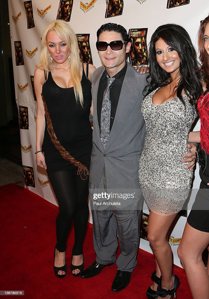 Actor <a gi-track='captionPersonalityLinkClicked' href=/galleries/search?phrase=Corey+Feldman&family=editorial&specificpeople=175941 ng-click='$event.stopPropagation()'>Corey Feldman</a> (C) attends the Premiere of '6 Degrees Of Hell' at Laemmle's Music Hall 3 on November 20, 2012 in Beverly Hills, California.