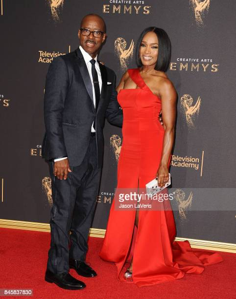 Actor Courtney B Vance and actress Angela Bassett attend the 2017 Creative Arts Emmy Awards at Microsoft Theater on September 10 2017 in Los Angeles...