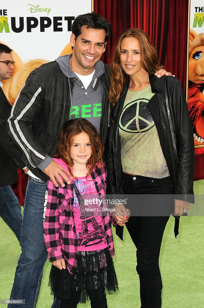 Actor Cristian de la Fuente and actress Angelica Castro with daughter Laura arrive for 'The Muppets' Los Angeles Premiere held at the El Capitan Theatre on November 12, 2011 in Hollywood, California.
