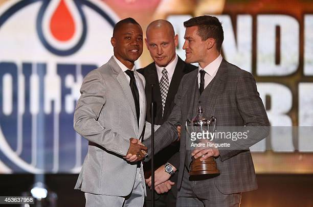 Actor Cuba Gooding Jr and former NHL player Adam Graves present Andrew Ference of the Edmonton Oilers the King Clancy Memorial Trophy onstage during...