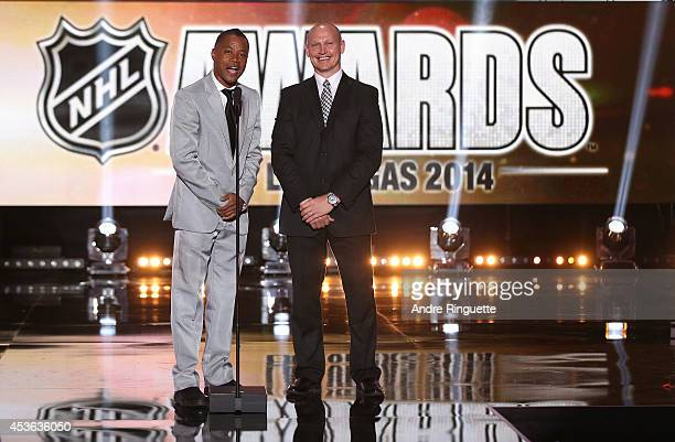 Actor Cuba Gooding Jr and former NHL player Adam Graves speak onstage during the 2014 NHL Awards at the Encore Theater at Wynn Las Vegas on June 24...