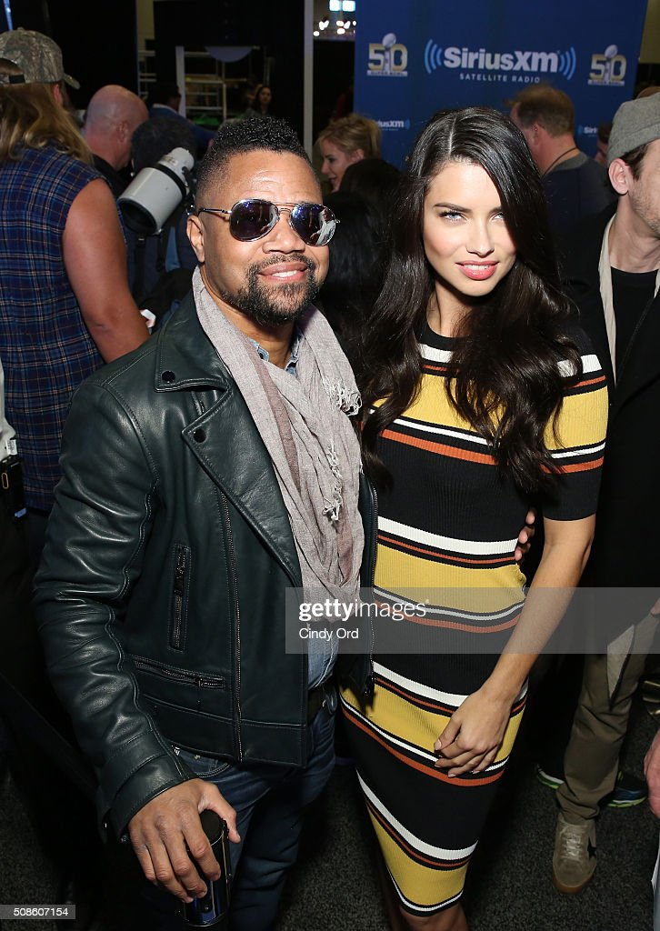 Actor Cuba Gooding Jr. and model Adriana Lima visits the SiriusXM set at Super Bowl 50 Radio Row at the Moscone Center on February 5, 2016 in San Francisco, California.