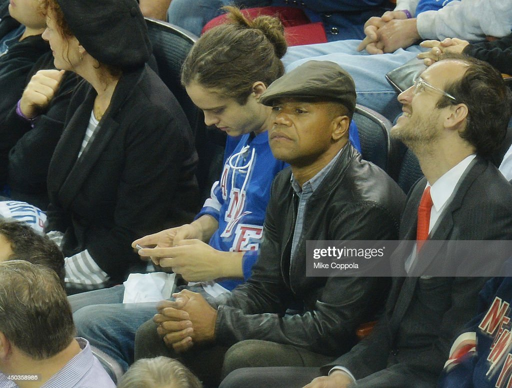 Actor <a gi-track='captionPersonalityLinkClicked' href=/galleries/search?phrase=Cuba+Gooding+Jr.&family=editorial&specificpeople=208232 ng-click='$event.stopPropagation()'>Cuba Gooding Jr.</a> (3rd from L) attends game 3 of the 2014 NHL Stanley Cup Final at Madison Square Garden on June 9, 2014 in New York City.