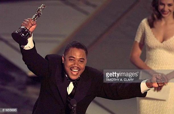 Actor Cuba Gooding Jr holds up his Oscar after winning the Best Supporting Actor Award for his role in 'Jerry Maguire' during the 69th Academy Awards...